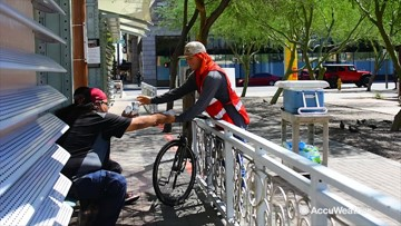 Volunteers hand out water to homeless as Phoenix heats up