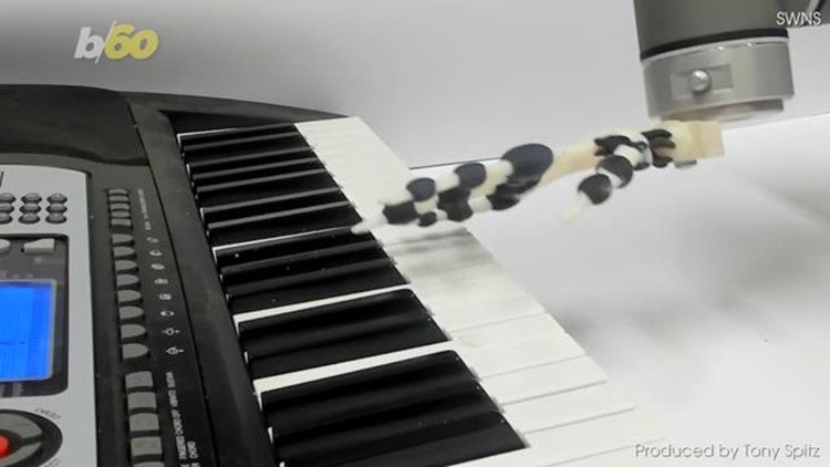 Move Over, Keyboard Cat! Watch This Robotic Hand Play Christmas Songs on the Piano