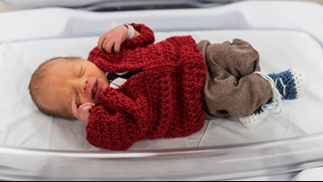 Newborns dressed like Mister Rogers as his wife visits Pittsburgh hospital