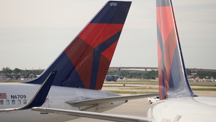 'Stop this plane!' Delta flight diverted after passenger tries to break into cockpit