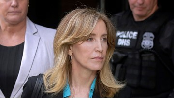 Felicity Huffman reports to prison to begin sentence in college admissions scandal