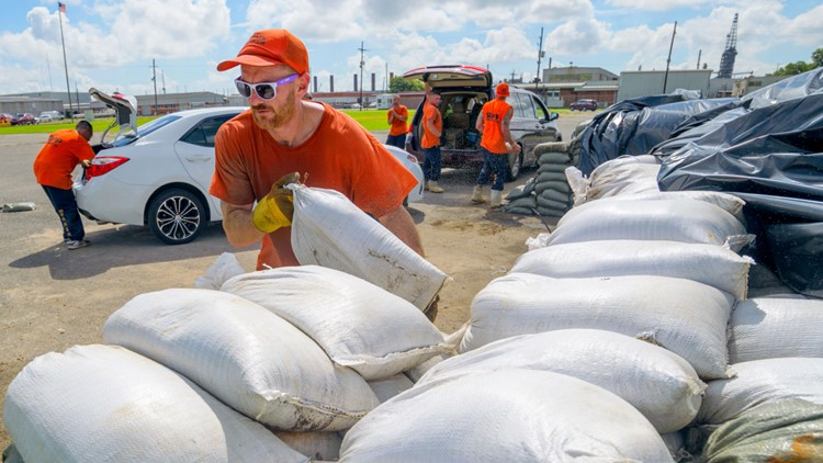 Tropical Weather sandbags inmate help