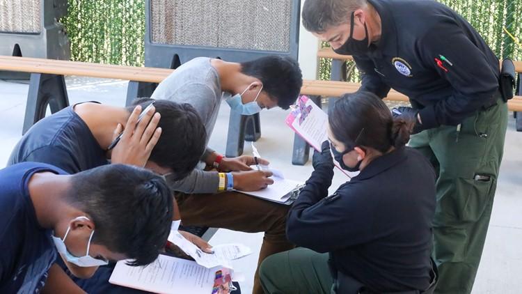 US border agents get help on custody work, return to field