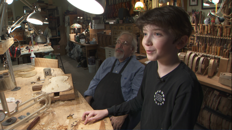 Master violin-maker Will Batruff (left) is passing on his skills to 13-year-old Ben Milne