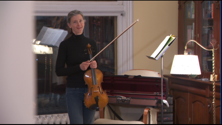 Susan Janda plays the viola her son Ben made for her