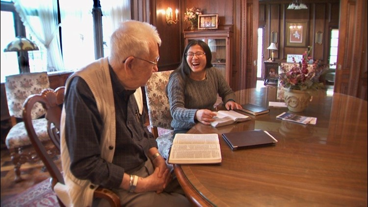 Winona State University student Ashley McGaw shares a laugh during bible study with 89-year-old Allen Thompson.