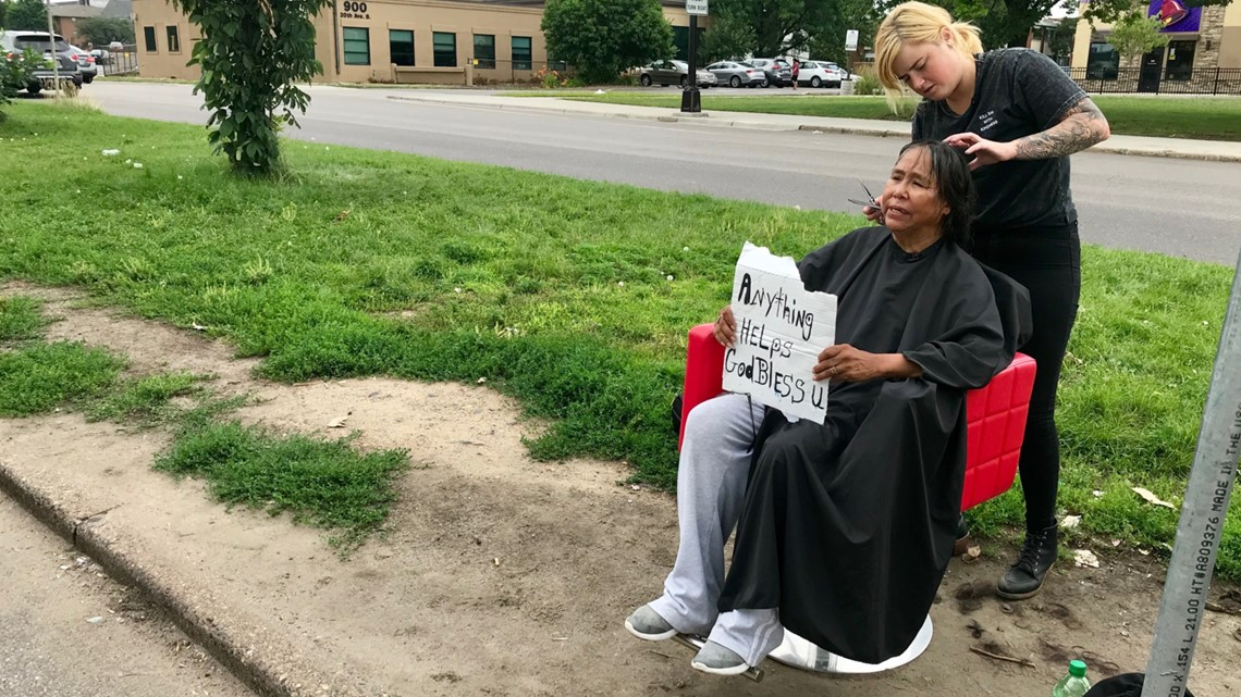 Hair stylist carries her red salon chair to the homeless