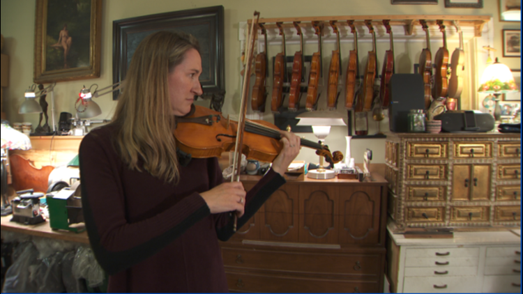 Professional musician Allison Ostrander plays a violin made by then 10-year-old Ben Milne
