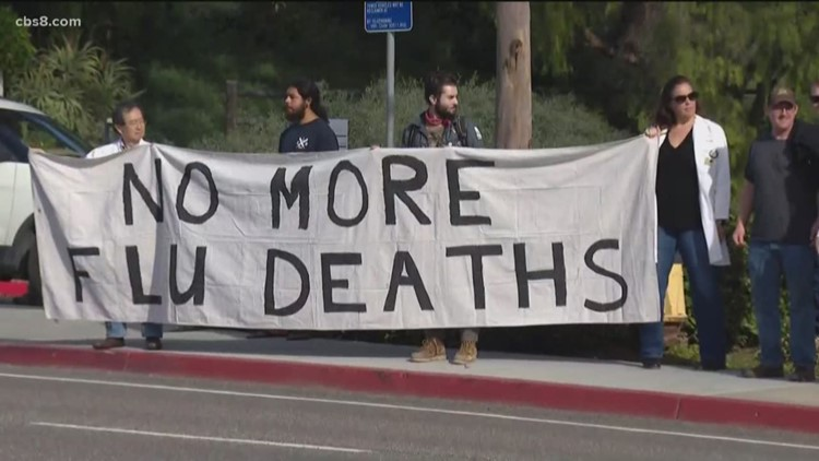 Doctors denied access to offer flu shots at migrant shelters continue protesting in San Diego