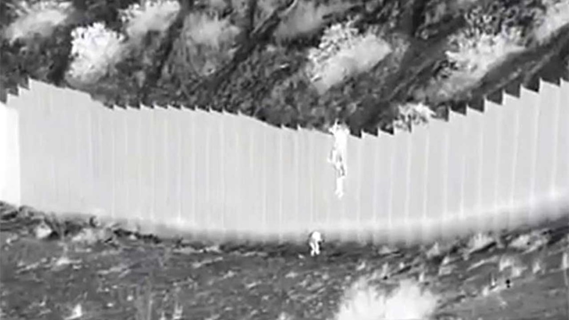 Video captures suspected smugglers drop two young girls over 14-foot fence into US