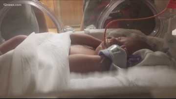 Phoenix woman goes to hospital with abdominal pain, delivers baby instead
