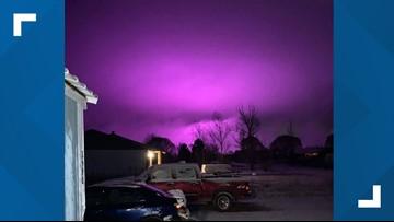 Medical marijuana farm lights create purple hazy sky