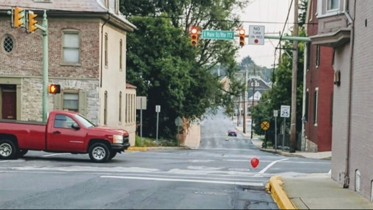 <p>The Lititz police department on Tuesday posted photos of red balloons a prankster tied to a pair of sewer grates</p>