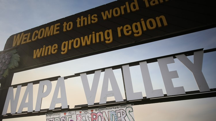 OAKVILLE, CA - OCTOBER 16: A handmade sign is seen attached to the Napa Valley welcome sign on October 16, 2017 in Oakville, California. At least 40 people are confirmed dead, dozens are still missing, and at least 5,700 buildings have been destroyed since wildfires broke out a week ago. (Photo by Elijah Nouvelage/Getty Images)