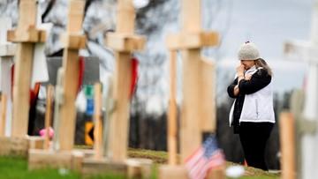 Crosses outside Paradise drive home devastation