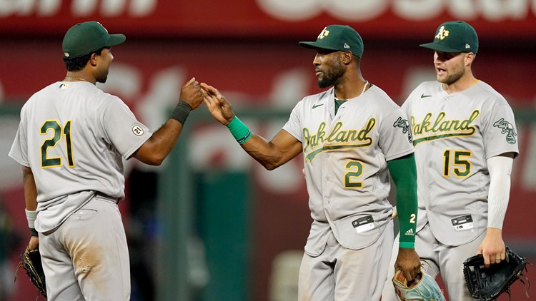 A's hold off Royals 12-10 to keep pace in AL wild-card race