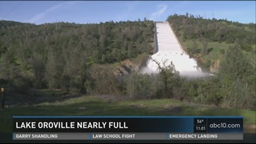 Oroville Dam releasing water over spillway for first time in