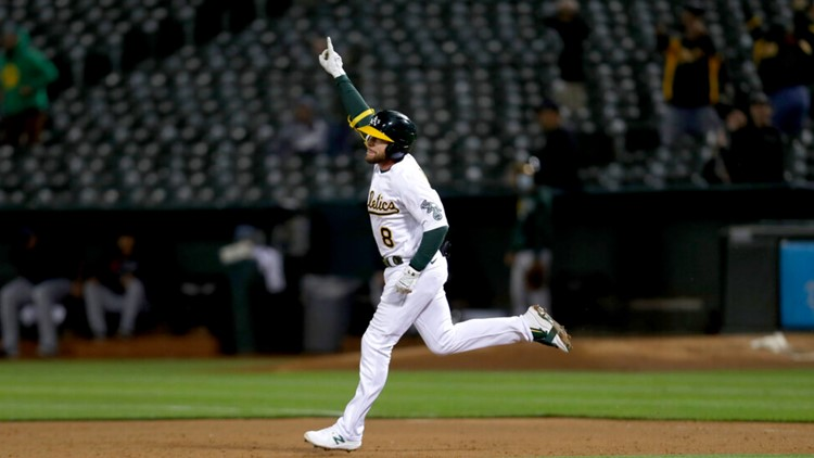 Lowrie's walk-off 2-run homer lifts A's over Indians 5-4a