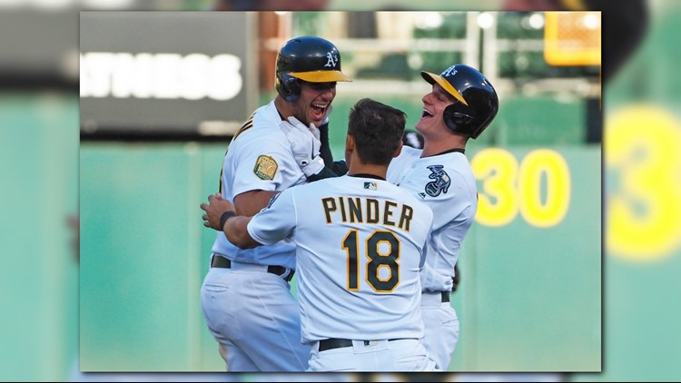 A's beat Chisox in 14-inning affair
