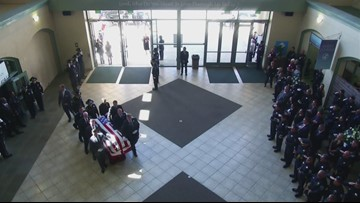 Officer Tara O'Sullivan and family arrive at memorial service