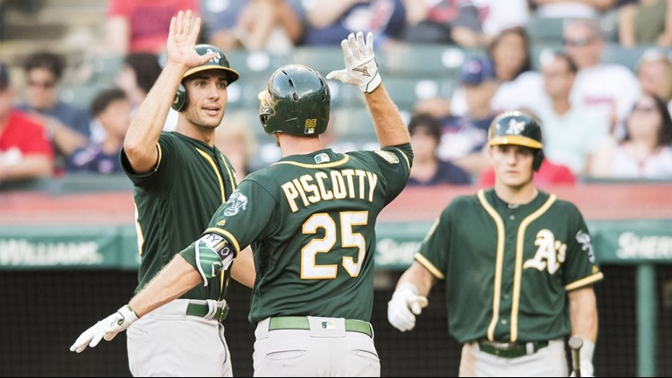 Stephen Piscotty hit a go-ahead, two-run homer in the 11th inning and the Oakland Athletics rallied for a 6-3 victory over the Cleveland Indians on Saturday.