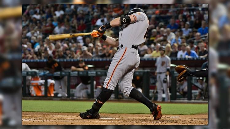 Evan Longoria's solo home run in the eighth inning led the San Francisco Giants to a 3-2 win over the Arizona Diamondbacks on Sunday.