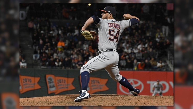 Roberto Osuna got the win in his first appearance with Houston after Marwin Gonzalez hit a three-run homer with two outs in the ninth inning, lifting the Astros over the San Francisco Giants 3-1 on Monday night.