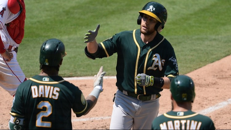 Jed Lowrie homered and moved over 1,000 hits for his career, and the Oakland Athletics held on for an 8-7 victory over the Los Angeles Angels on Sunday, their ninth win in 11 games.