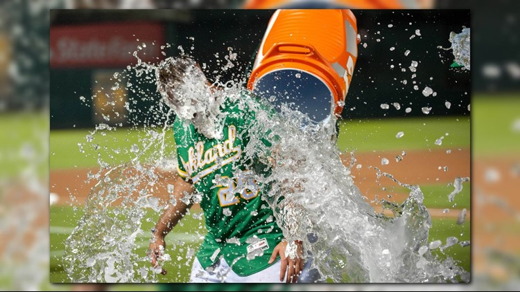 Matt Olson hit a leadoff home run in the 10th inning after a video review gave Oakland the tying run in the ninth, and the Athletics beat the Houston Astros 4-3 on Friday night to pull within a game of the reigning World Series champs for the AL West lead.