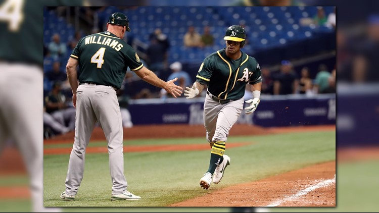 Khris Davis led off the 10th inning with his major league-leading 42nd homer, and the Oakland Athletics beat the Tampa Bay Rays 2-1 on Friday night.