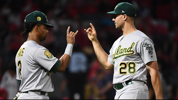 Khris Davis' 48th homer powers Oakland past Angels, 5-2