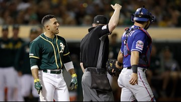 A's hit 4 HRs in testy 5-4 win over Rangers
