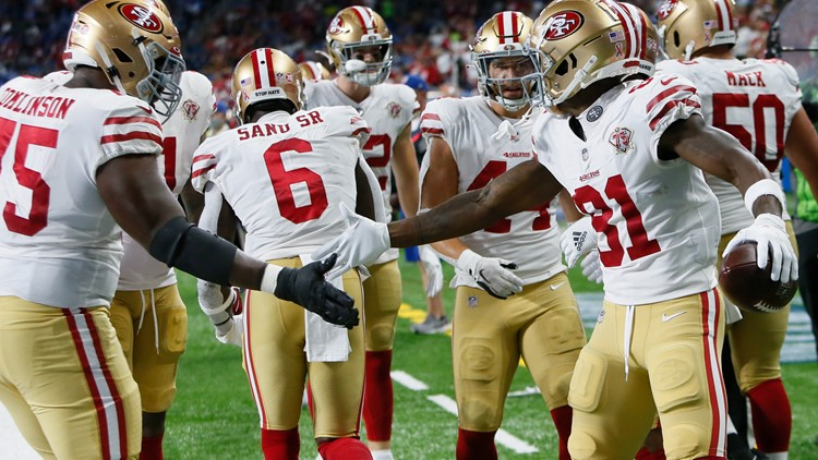 49ers build 28-point lead, hold on for 41-33 win over Lions