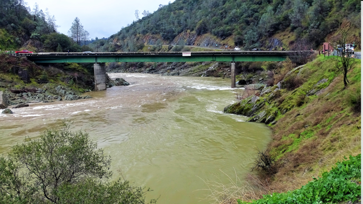 Why Guy: Why are there barrels hanging above the American River?