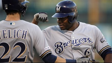 Cain gets Brewers off to fast start in 4-2 win over A's