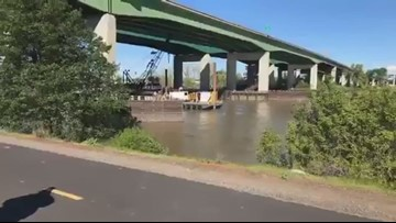 Crews work to pull tow truck from Sacramento River