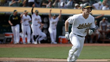 Canha doubles in 11th, A's edge KC 1-0 to hold wild card lead