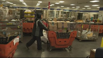 Postal workers start early to deliver packages in the holiday season