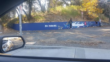 Iconic 'No Barking' graffiti returns to Fair Oaks lot