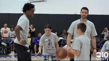 De'Aaron Fox visits with kids at his Kings basketball camp; teaches one a lesson