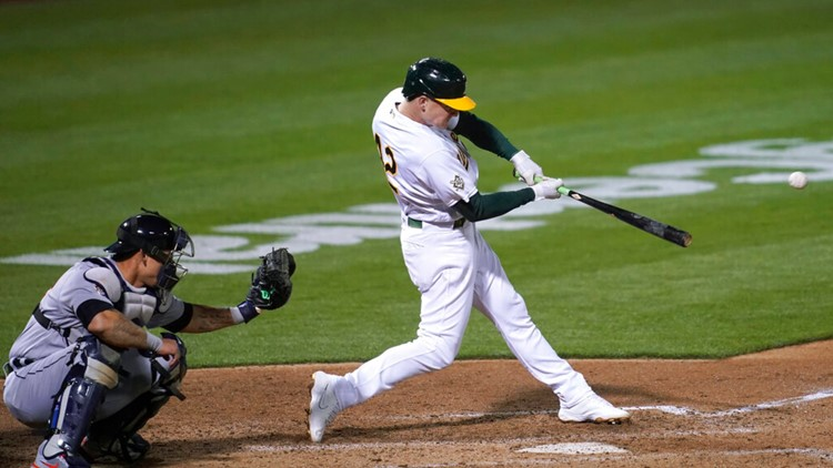 A's pound Tigers, back Manaea's 1st victory of season, 8-4