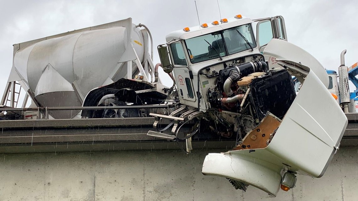 One person injured after big rig hangs over I-80 and Watt ...