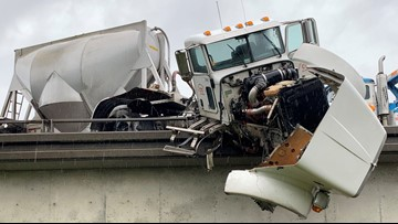 One person injured after big rig hangs over I-80 and Watt Avenue overpass