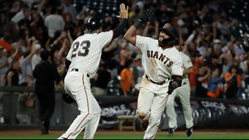 Davis hits first career home run to lift Giants past Rox