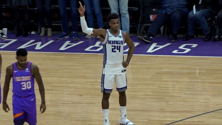 Hield breaks Peja's franchise season record for three's in Kings win over Suns