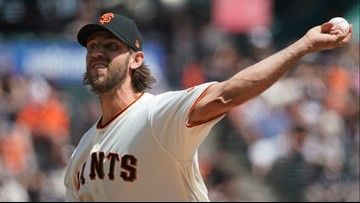 Bumgarner, Giants work fast, send Rockies to 8th loss in row