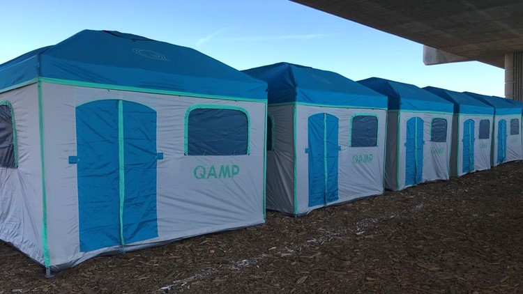 Uniformed tents for homeless set up under Modesto's 9th Street Bridge