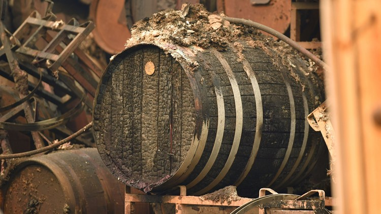 Burned wine barrels are seen at a destroyed Paradise Ridge Winery in Santa Rosa, California on October 10, 2017. Firefighters encouraged by weakening winds were battling 17 large wildfires on Tuesday in California which have left at least 13 people dead, thousands homeless and ravaged the state's famed wine country. / AFP PHOTO / JOSH EDELSON (Photo credit should read JOSH EDELSON/AFP/Getty Images)