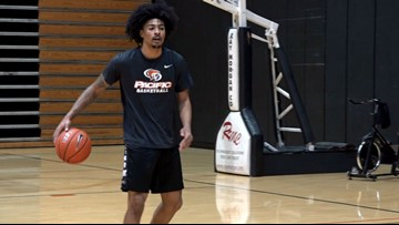 Pacific senior guard Roberto Gallinat prepares for NCAA dunk contest at Final Four