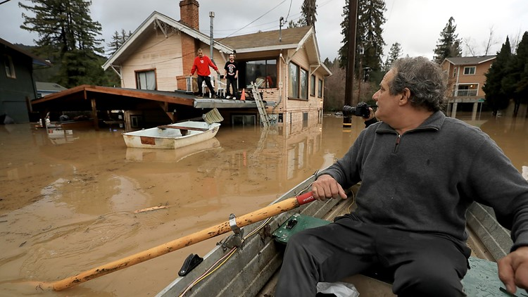 California man swept away by flood trying to reach kids